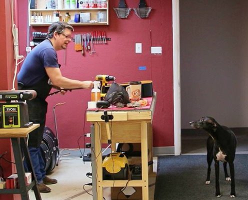 Rick in the shop with Running Dogs mascot Keaton.